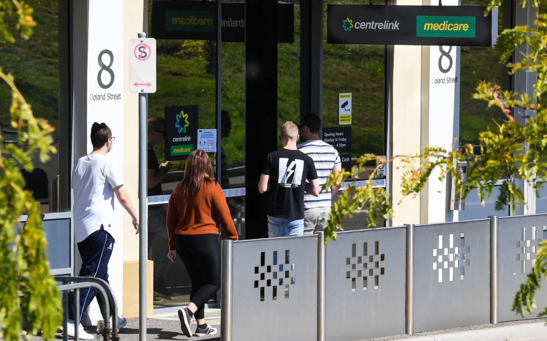 Young people enter Centrelink in Launceston in March as the COVID crisis started to cripple Australia's economy and cause mass job losses. Picture: Neil Richardson