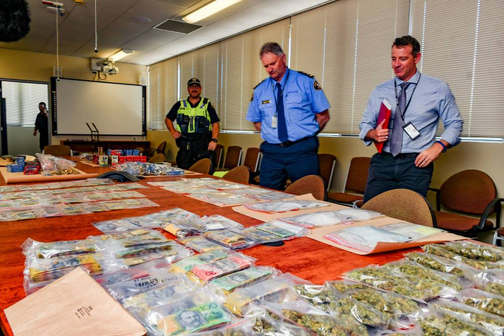 Police display a large amount of crystal methamphetamine, cannabis and ecstasy following a raid on a hotel in central Launceston. Picture: Scott Gelston