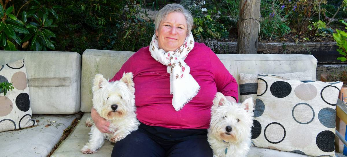 WELFARE: Jan Davis and two of her dogs Kiwi and Loki. Picture: Neil Richardson