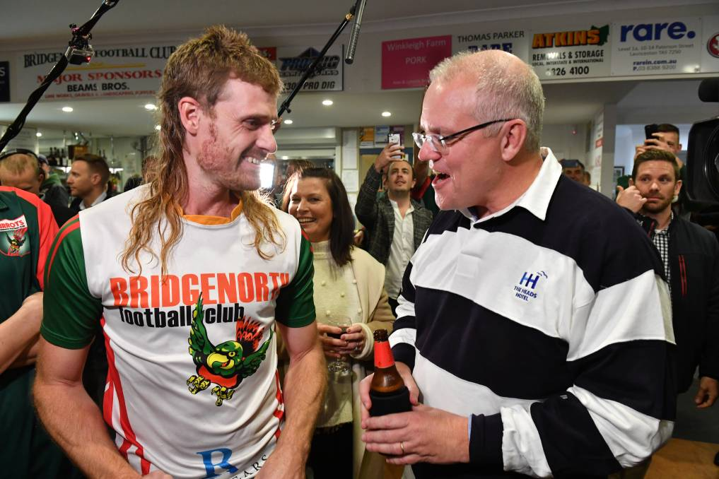 Sharing a yarn: Bridgenorth Football Club's Jarrad Cirkel and Prime Minister Scott Morrison have a chat over a beer. Picture: AAP