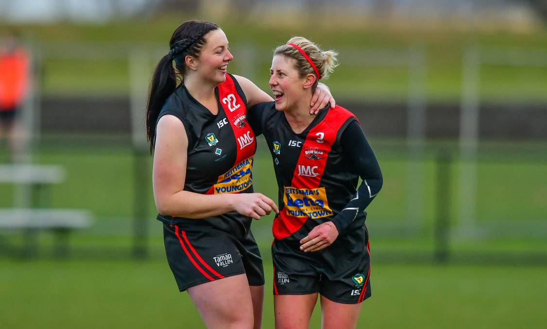 Happy times: North Launceston captain Jodie Clifford (right) celebrates with Emily McKinnell.