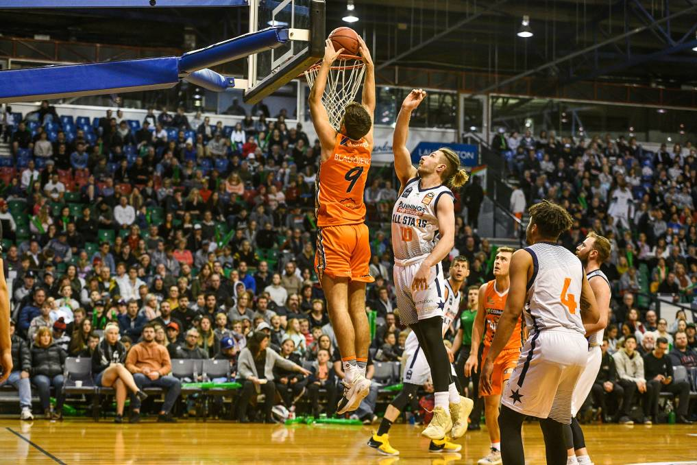 SILVERDOME SLAM: Cairns Taipans' George Blagojevic dunks over an NBL1 All Stars opponent during the NBL Blitz at the Silverdome in late 2019.