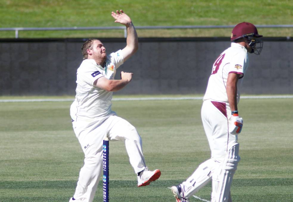 FULL FLIGHT: Jarrod Freeman bowls against Queensland at Bellerive Oval last week. Pictures: Rick Smith