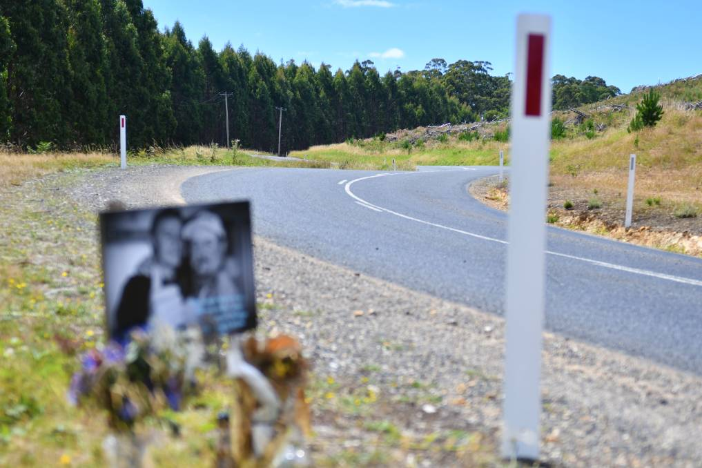 TRIBUTE: A photo and flower tribute has been laid at the side of the road where Wade Palmer died after crashing his motorbike in February 2020. A coroner has found speed and inattention caused the fatal crash. Picture: Brodie Weeding