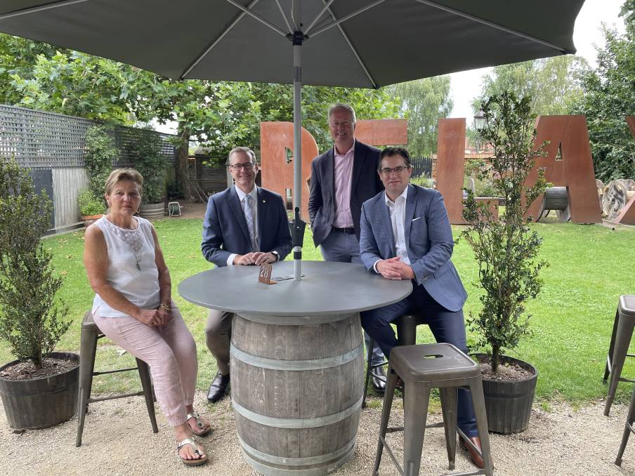 Take a breath: Clarendon Arms owner Lydia Nettlefold with Michael Ferguson, John Fitzgerald and Paul Seaman. Picture: Ebony Abblitt