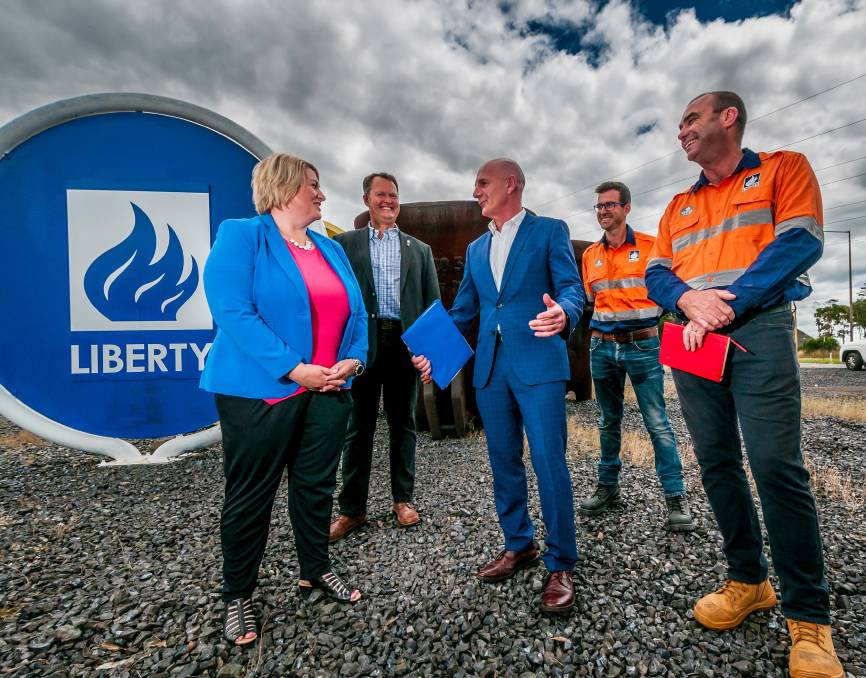 Good news: Susie Bower, Greg Kieser, Premier Peter Gutwein, Robert Evans and Richard Curtis celebrate the sale of the smelter. Picture: Phillip Biggs