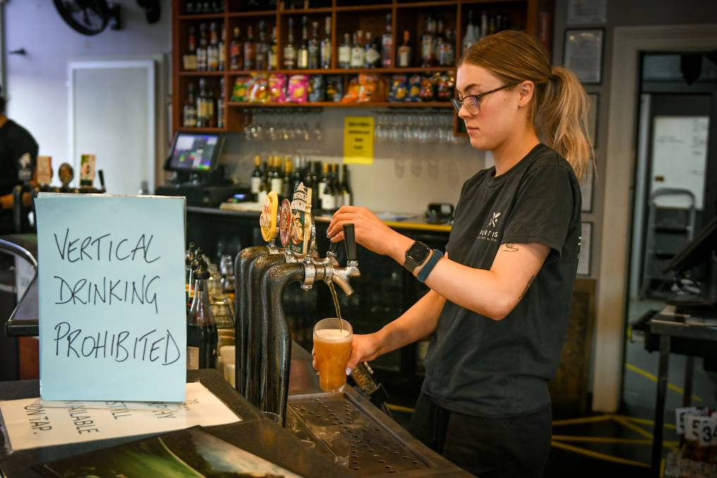 Bronte Marshall pulls a beer at Sporties Hotel. Picture: Paul Scambler