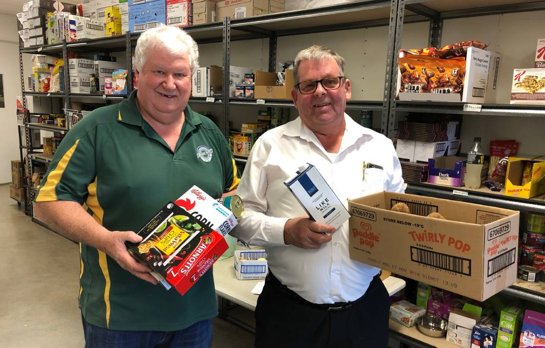 LOADING UP: Launceston Benevolent Society chief executive John Stuart and board member Robert Anderson handle some of the produce the organisation has on offer. Picture: Rob Inglis