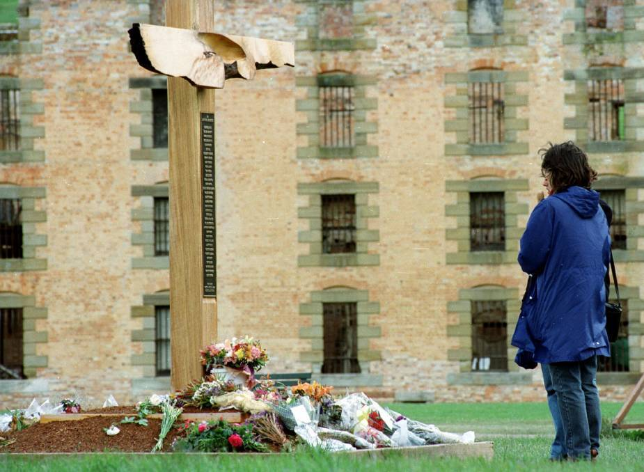 A visitor stops at a memorial dedicated to victims of the Port Arthur massacre.