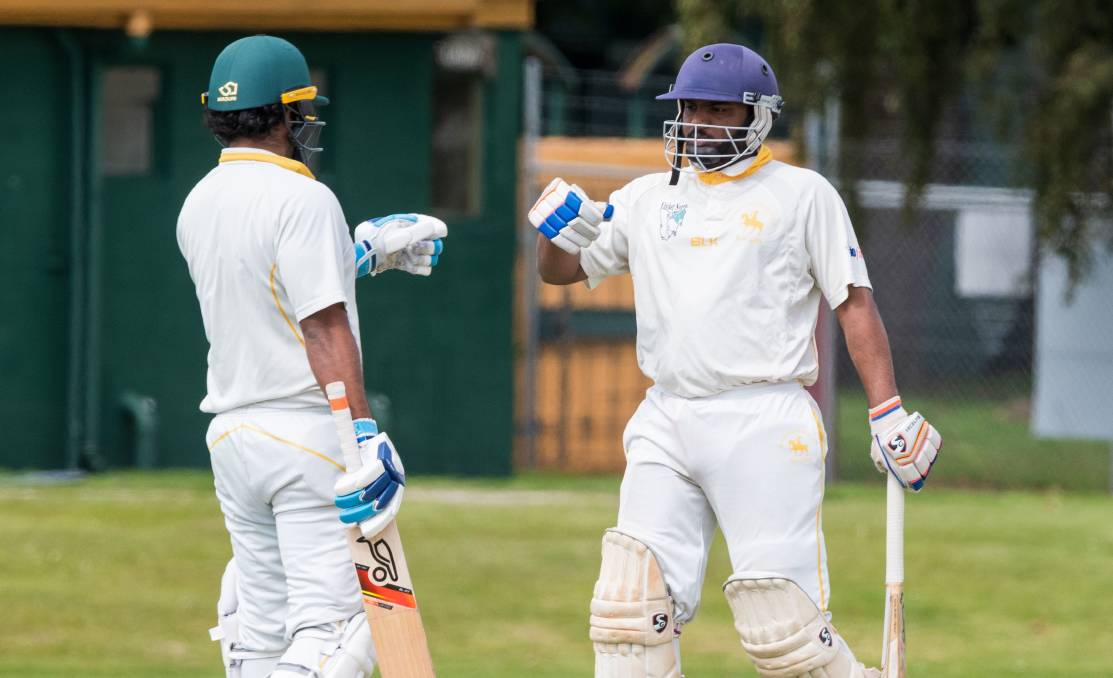 ON TOP: Leading South Launceston batsmen Istha Jayasinghe and Ishang Shar had plenty to celebrate, choosing fist bumps with their batting gloves towards marking the Knights' 187-run victory over Launceston. Picture: Phillip Biggs