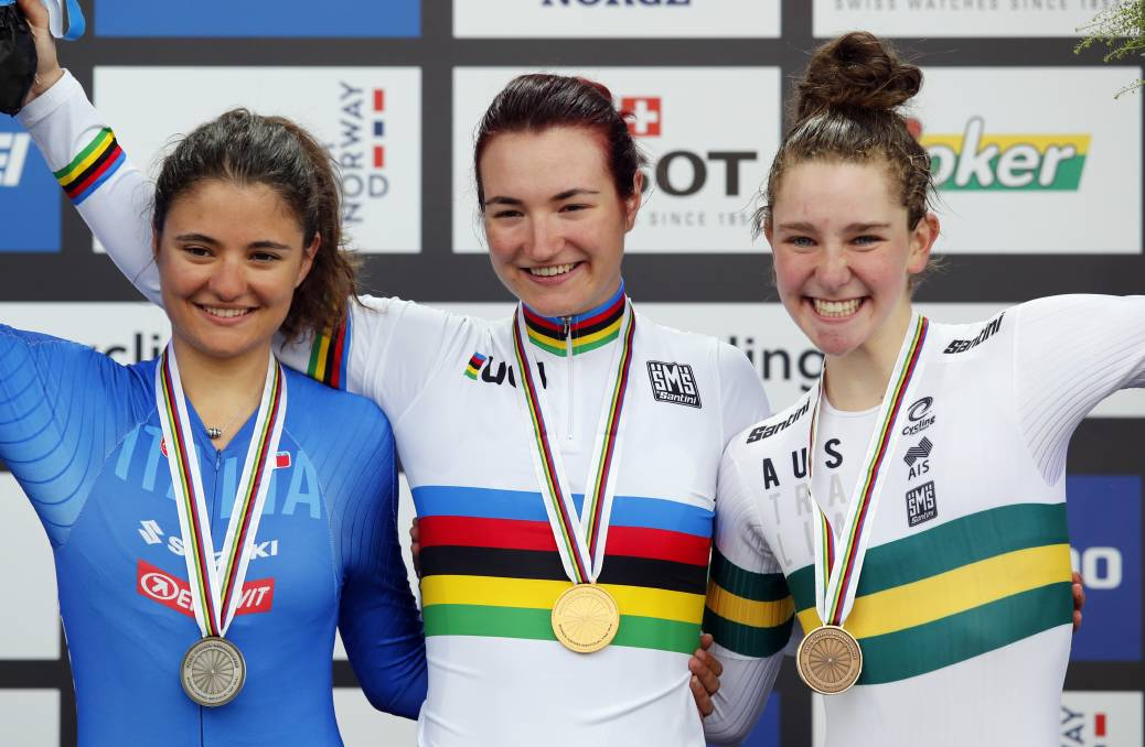 ONE MEDAL NOT ENOUGH: ICU world championships junior time-trial bronze medallist Madeleine Fasnacht, right, on the podium earlier in the week. Picture: AP