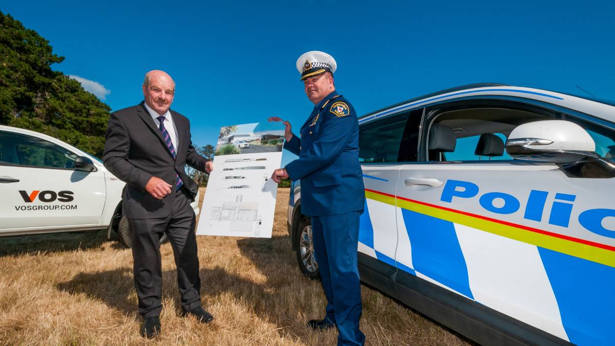 PROGRESS: Police, Fire and Emergency Management Minister Mark Shelton and Acting Inspector Stuart Wilkinson with plans for the new police station at Longford. Picture: Phillip Biggs