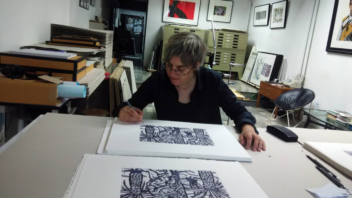 Artist Jen Tyers signing etchings. Picture: Supplied