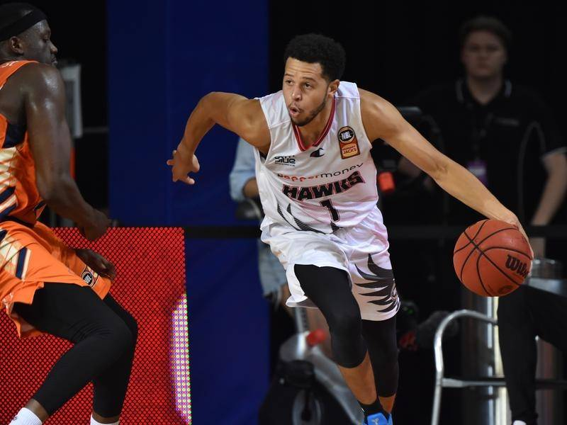 Impressive import Tyler Harvey has led the unbeaten Hawks to a 90-82 win over the Brisbane Bullets.