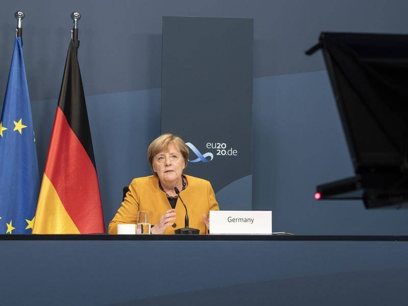 Angela Merkel has marked 15 years as German chancellor while attending the virtual G20 Summit.