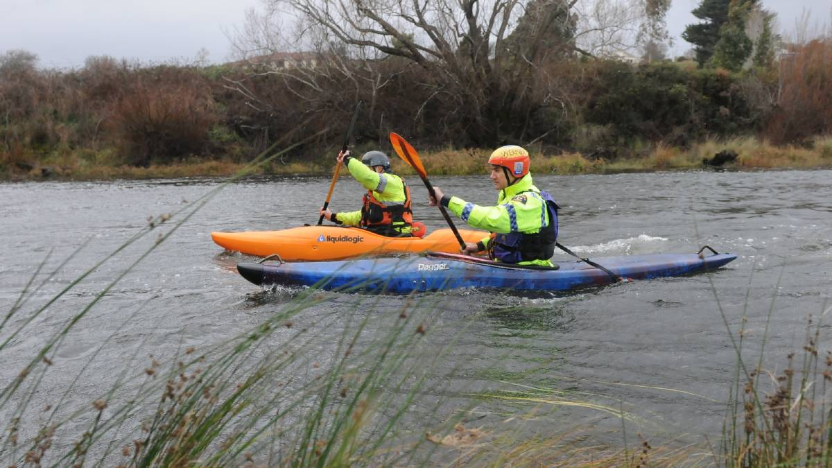 Constable Dan Smith and Senior Constable Ross McIvor in a previous search of the South Esk River for Ben Plowright, 20.