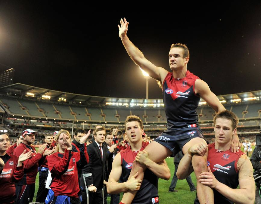 Waving goodbye: Brad Green salutes Melbourne fans as he leaves the MCG following his last game in 2012. Picture: The Age