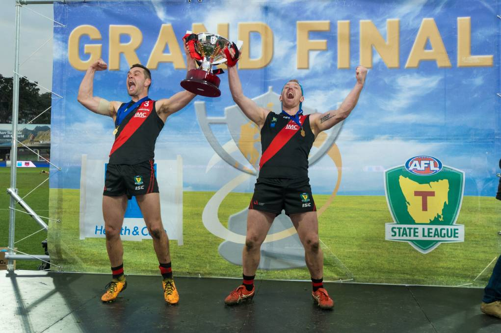 Bombs away: Taylor Whitford and Brad Cox-Goodyer celebrate after North Launceston beat Lauderdale in this year's State League grand final. Picture: Phillip Biggs