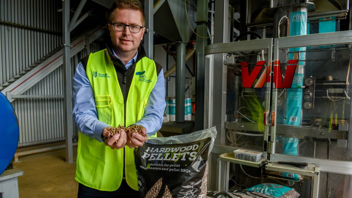 VALUE ADDING: Neville-Smith Forest Products chief executive Andrew Walker with wood pellets produced at Mowbray. Picture: Paul Scambler