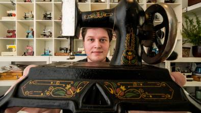 ALL SEWN UP: Smith & Sons employee Jack Hilton shows off some of the sewing machine collection at Smith & Sons Emporium in the Quadrant Mall. Picture: Phillip Biggs.