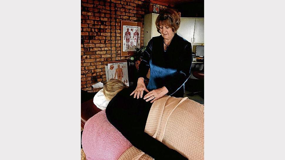 Barbara Gilbery, of Spreyton, applies bowen therapy to a client. Picture: GEOFF ROBSON